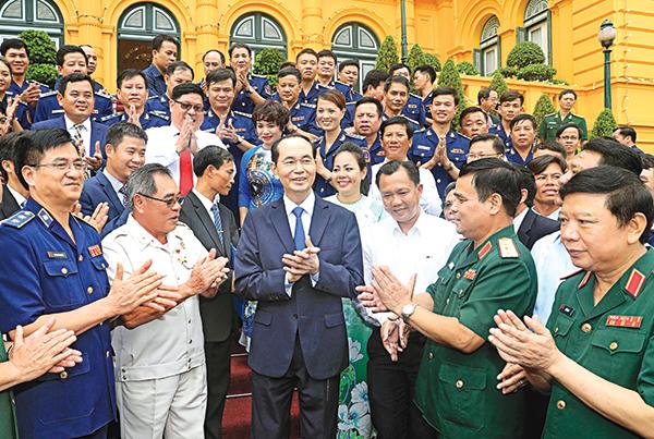 Chủ tịch nước Trần Đại Quang với các đại biểu. Ảnh: Nhan Sáng-TTXVN