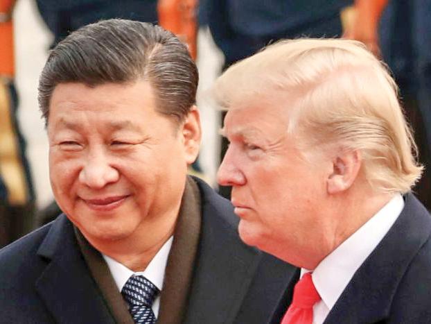 Cuộc gặp giữa Tổng thống Trump (phải) và Chủ tịch Tập là tâm điểm tại thượng đỉnh G20. Ảnh: AP