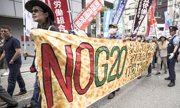 Người biểu tình phản đối hội nghị thượng đỉnh G20 ở Osaka. Ảnh: Getty Images