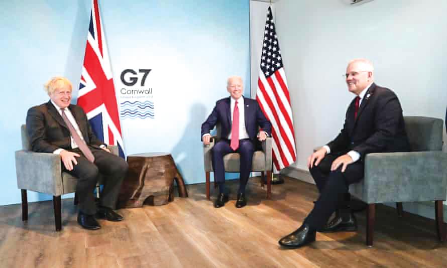 Từ tráng sang: Thủ tướng Anh Johnson, Tổng thống Mỹ Joe Biden và lãnh đạo Úc Morrison. Ảnh: Getty Images