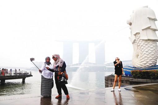 Khách du lịch đến Singapore tăng nhờ thượng đỉnh Mỹ - Triều