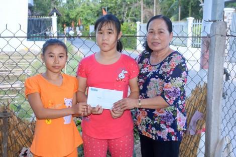 Giúp 2 trẻ mồ côi có điều kiện tiếp tục đến trường