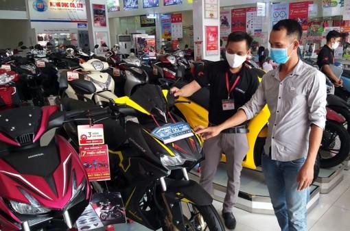Thị trường xe gắn máy vẫn trầm lắng