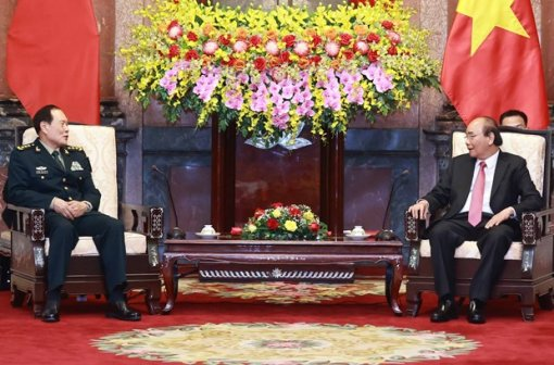 Armies' successful ties help reinforce Vietnam-China relations: President