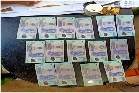 Bắt khẩn cấp đối tượng nghi tàng trữ tiền giả